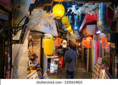Tokyo, Japan - Feb 24 , 2019 : Omoide Yokocho at Shinjuku ,The famous place for eat and drink hangout , Winter season decorated with white leaf
