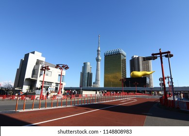 """TOKYO JAPAN - February 05, 2018 : Asahi Breweries headquarters building with the """"Asahi Flame"""" or Asahi Beer Hall was designed by Philippe Starck, view from Asakusa Station, Tokyo, Japan"""