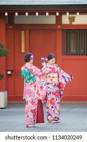 Tokyo, Japan - February 11, 2016 : two young Japanese ladies in kimono selfie themself at Sensoji, Asakusa Kannon Temple on February 11, 2116 at Tokyo, Japan.
