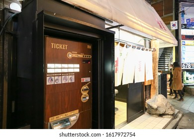TOKYO, JAPAN - FEBRUARY 13: Ramen vending machine on wood design in fron of restaurant February 13, 2017 in Tokyo, Japan