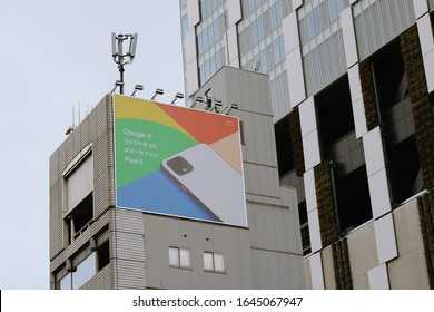 TOKYO, JAPAN - February 14, 2020: A billboard at the top of a building advertising Google Pixel smartphones. The larger modern building is Shibuya Stream, location of Google's Japanese head office.