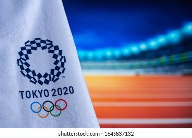 TOKYO, JAPAN, FEBRUARY. 14. 2020: Tokyo 2020 Olympic logo, Athletics stadium in background