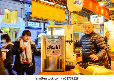 TOKYO, JAPAN - February 16, 2017 - Old man sell Asahi Lager beer , Made by Asahi Breweries, Ltd in Japan since 1889.