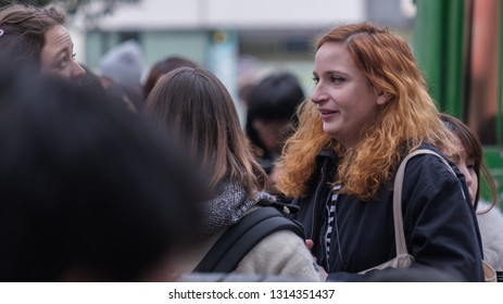 TOKYO, JAPAN - FEBRUARY 16TH, 2019. Foreign female tourists at Shibuya Hachiko's square during winter.