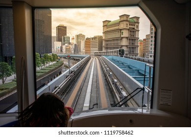 Tokyo, Japan - February 18, 2017 : Yurikamome Train heading to Odaiba. The train is an automated elevated train which connects Shimbashi Station on the Yamanote Line with all of Odaiba
