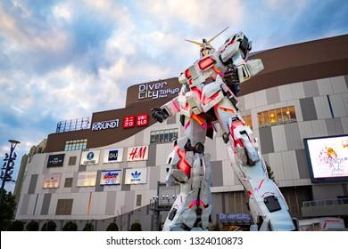 TOKYO, JAPAN - FEBRUARY 21, 2019: A life-sized RX-0 Unicorn Gundam statue on display outside DiverCity Tokyo Plaza in Odaiba, Tokyo. The Unicorn Gundam is anime robot in Gundam series.