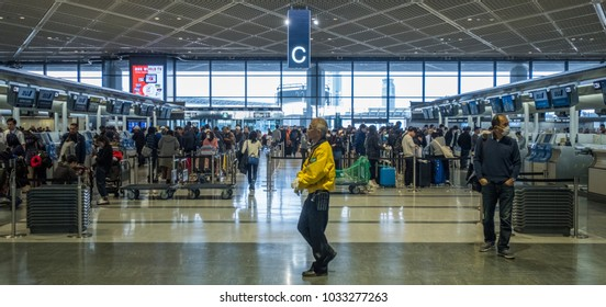 TOKYO, JAPAN - FEBRUARY 23RD, 2018. Passengers at Narita International Airport departure hall.