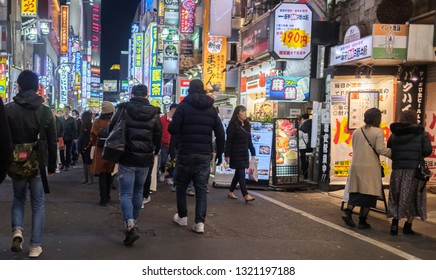 TOKYO, JAPAN - FEBRUARY 23RD, 2019. Crowd of people walking in the street of  Kabukicho district at night.