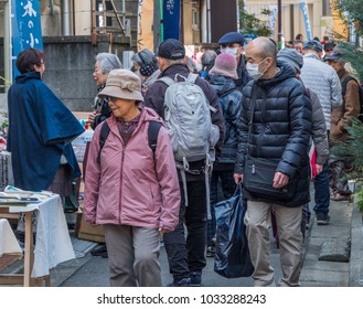 TOKYO, JAPAN - FEBRUARY 24TH, 2018. Tourist and visitors in the street at Fabric Dyeing Festival in Shinjuku.