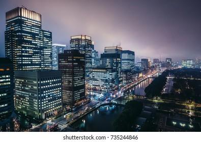 Tokyo, Japan - February 26, 2015: Night view on Marunouchi commercial dsitrict with Shin Marunouchi, Marine Nichido, Nippon Yusen, Mitsubishi Shoji buildings