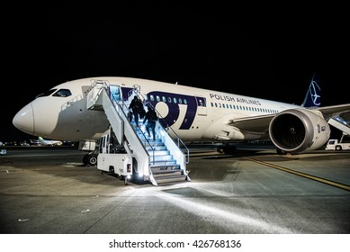 TOKYO, JAPAN - FEBRUARY 27, 2015. Passengers enters on board of Boeing 787 Dreamliner of LOT Polish Airlines on airport in Tokyo