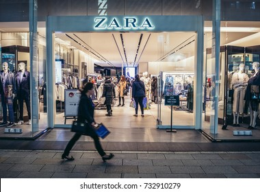 Tokyo, Japan - February 27, 2015: Woman walks in front of Zara shop in Ginza district in Tokyo