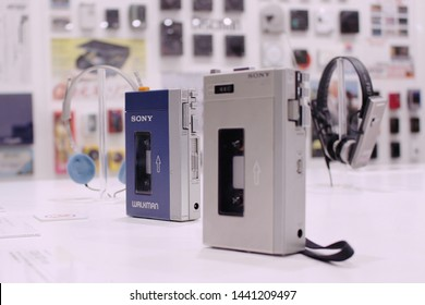TOKYO, JAPAN - February 3, 2017: Original model Sony Walkman with its predecessor the Pressman. Items displayed at Ginza's former Sony Building (now site of Sony Park). Focus is on the Walkman.