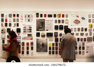 TOKYO, JAPAN - February 3, 2017: A display case with different models of Sony Walkman at an exhibition held at now under-defunct Sony Building in Ginza. Some motion blur.