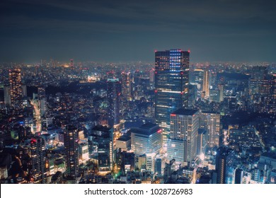 Tokyo, Japan - February 3, 2018: Modern cityscape building aerial view at night, capital city of Japan, business city concept image, shot in Roppongi Hills of Minato Ward, Tokyo, Japan.