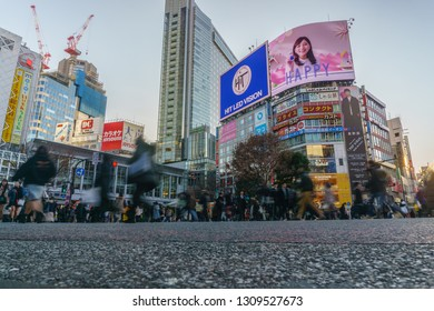 Tokyo, Japan - February 3 , 2019 : Pedestrians cross at Shibuya Crossing in Tokyo , Japan.