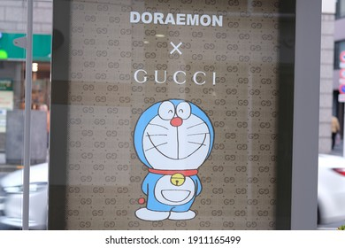 Tokyo, Japan - February 5 2021: Luxury brand Gucci collaborates with popular cartoon, manga, anime character Doraemon. Advertisement at a Tokyo bus stop.
