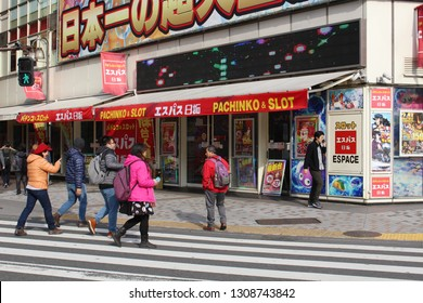 TOKYO, JAPAN - February 7, 2019: A pachinko and slot center on the corner of a street in Shinjuku.
