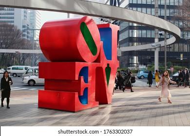 TOKYO, JAPAN - February 7, 2019: Street in Tokyo's Shinjuku area with a  Robert Indiana 'Love' sculpture.