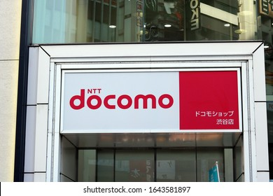 TOKYO, JAPAN - February 7, 2020:  The sign above the entrance of a branch of the cellphone service provider NTT DOCOMO.