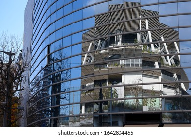 TOKYO, JAPAN - February 8, 2020 : Reflected view of the New National Stadium in Tokyo, Japan. The stadium is to be used as the main stadium for the 2020 Summer Olympics