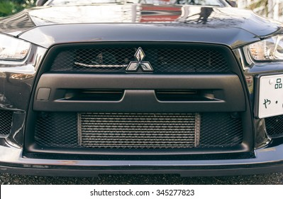 Tokyo, Japan. February 9th, 2015. The Mitsubishi Lancer evo front spoiler. It is a high performance sports sedan manufactured by Mitsubishi Motors that is based on the normal Lancer