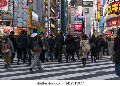 Tokyo, Japan - Febuary,03 2019 : Crowd undefined people crossing street entrance of Kabukicho, Japan Godzilla statue in Tokyo street landmark location of colorful signs in shinjuku