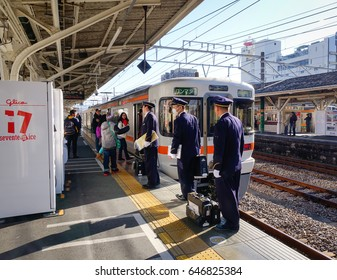 Tokyo, Japan - Jan 1, 2016. Staffs working at railway station in Tokyo, Japan. Railways are the most important means of passenger transportation in Japan.