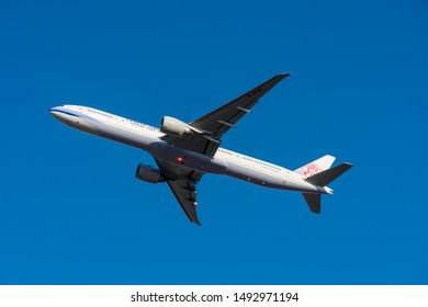 TOKYO, JAPAN - JAN. 13, 2019: China Airlines Boeing 777-300ER Tripleseven taking off from the Narita International Airport in Tokyo, Japan.