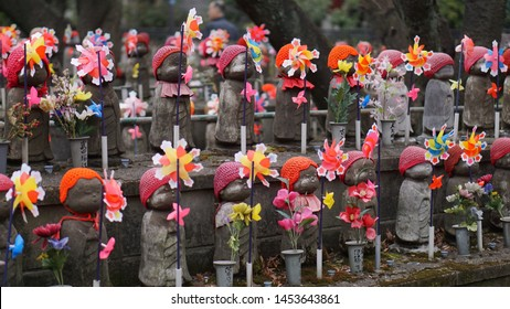 "Tokyo, Japan - Jan 31, 2019 : Rows of stone Buddhas, also known as Jizo at Zojo-ji Temple, ""JIZO"" represent souls of unborn children who died by stillbirth, abortion or miscarriage."