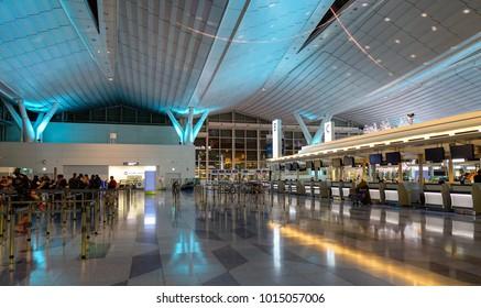 Tokyo, Japan - Jan 4, 2016. People waiting at Departure Terminal of Haneda Airport in Tokyo, Japan. Haneda was the primary international airport serving Tokyo until 1978.