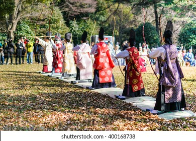 TOKYO, JAPAN - JAN 4: Traditional Japanese archers pictured on January 4th, 2016, in Tokyo, Japan. Traditional archery is one of the most popular tourist attraction in Meiji park in Tokyo.