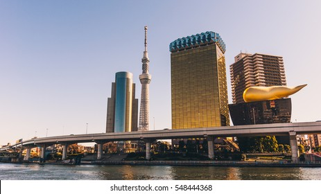 Tokyo, Japan - January 03, 2015:  View of the Tokyo skyline from across the river in Asakusa including the Tokyo Skytree and the Asahi Beer Hall