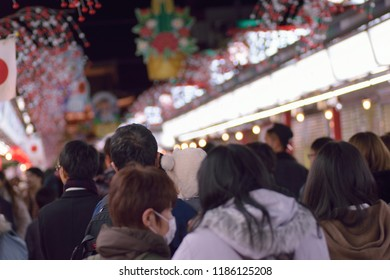 TOKYO, JAPAN - JANUARY 1 2018 : Crowds lined up to visit Asakusa temples in Tokyo, Japan taken on January 1, 2018. On new year's day thousands of people come to shrines & temples in Japan