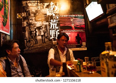 Tokyo, Japan, January 1 2019- two working class man hang out at the bar call izakaya at night after working hours. Its a common japanese culture that they would drink beer after working all day.