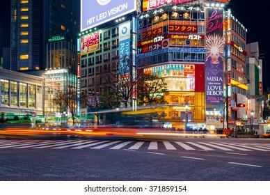 TOKYO, JAPAN - JANUARY 12, 2016: Pedestrians cross at Shibuya Crossing. It is one of the world's most famous scramble crosswalks.