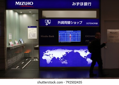 TOKYO, JAPAN - January 12, 2018: A currency exchange bureau operated by Mizuho Bank in Otemachi subway station in central Tokyo. A screen displays the exchange rates for various currencies.