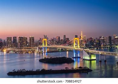 Tokyo, Japan - January 1,2017 : View of Tokyo Bay, Rainbow bridge and Tokyo Tower landmark, Twilight scene, Odaiba on January 1,2017 at Tokyo Japan