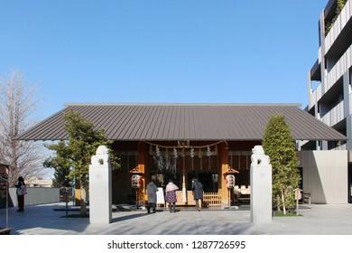 TOKYO, JAPAN - January 17, 2019: The Akagi Shrine in Kagurazaka which was designed by Kengo Kuma.  The building in the photograph is the shrine's Haiden.