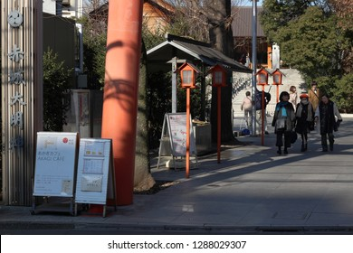 TOKYO, JAPAN - January 17, 2019: The entrance and precinct of Akagi Shrine in Kagurazaka including a sign and a leg of a Torii Gate. The shrine was designed by Kengo Kuma.