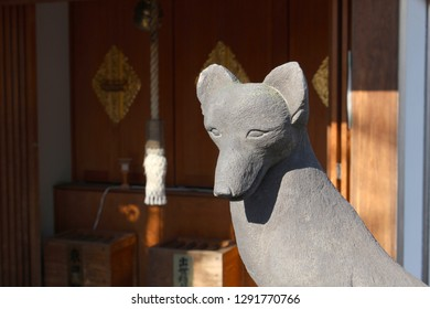 TOKYO, JAPAN - January 17, 2019: Detail of a fox statue which is located at Shusse Inari Jinja which is part of Akagi Shrine in Kagurazaka.