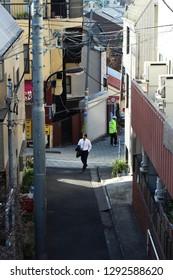 TOKYO, JAPAN - January 17, 2019:  A narrow hilly street in Tokyo's Kagurazaka area.