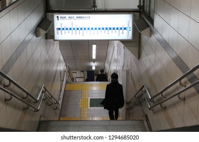 TOKYO, JAPAN - January 17, 2019: People walking down the stairs to a platform of Kagurazaka subway station which is on the Tozai Line.