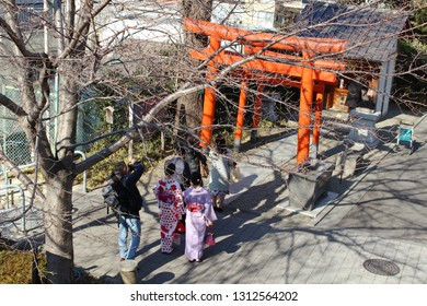 ]TOKYO, JAPAN - January 17, 2019: Visitors and locals wait in line to pray at Shusse Inari Jinja which is part of the Kengo Kuma-designed Akagi Shrine in Kagurazaka.