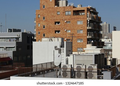 ]TOKYO, JAPAN - January 17, 2019: View from a hilltop of apartment buildings and air conditioner ventilation units on rooftops in Tokyo's Kagurazaka area.