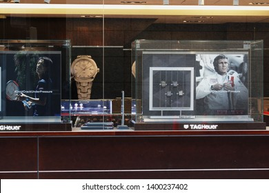 TOKYO, JAPAN - January 19, 2018: View of a window display in a Tag Heuer watch store in Ginza in central Tokyo. It inclues adverts featuring Steve McQueen & Kei Nishikoshi.