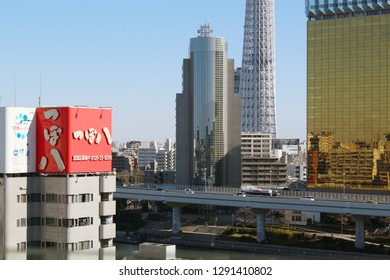 TOKYO, JAPAN - January 19, 2019: Overhead view of Tokyo's skyline including Tokyo Skytree, Asahi Breweries headquarters, the River Sumida  and the Shoto Expressway.