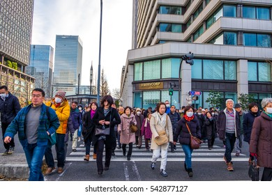 TOKYO, JAPAN - January 2, 2016: Crowds Japanese people walk to the Imperial Palace to greet the royal family during their New year.