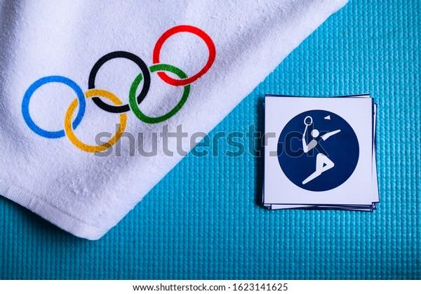 TOKYO, JAPAN, JANUARY. 20. 2020: Badminton pictogram and olympic rings. Original wallpaper for olympic game