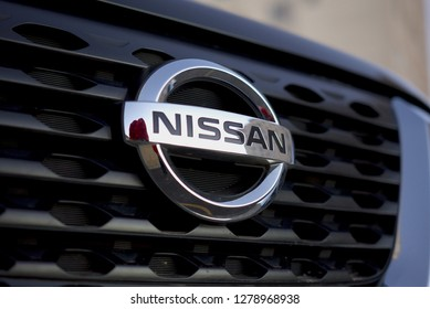 TOKYO, JAPAN - JANUARY 2019: Shiny silver Nissan Brand Sign on car. Nissan's president Carlos Ghosn is being investigated for fraud.